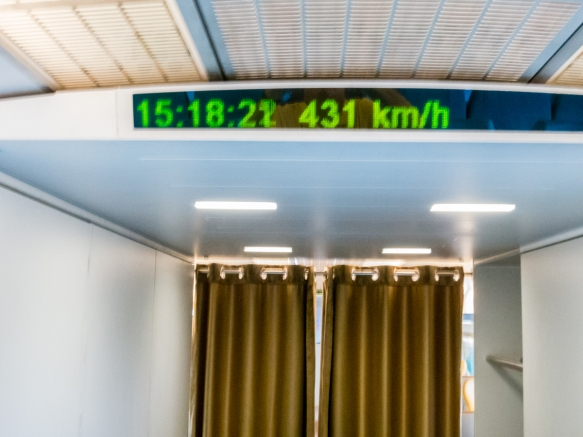 At 3-18 p.m. our train had hit its maximum speed, 431 kph (267.8 mph), which was very exciting because we couldn_t feel (in our seats) that we were flying by the landscape so quickly,