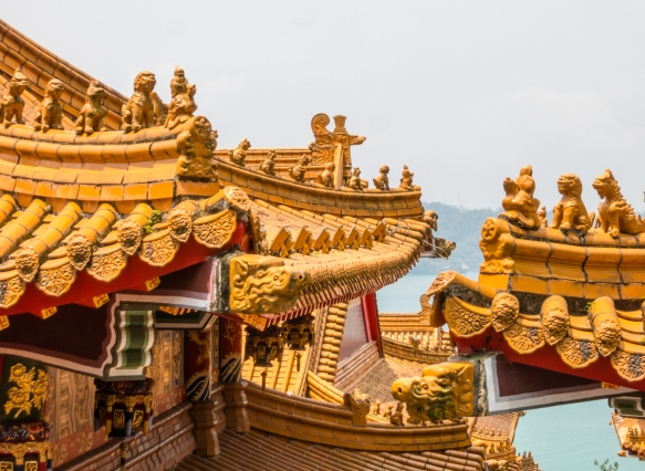 Chinese guardian figures decorate the edges of the roofs at Wen-Wu Temple, Sun Moon Lake, Taichung, Taiwan