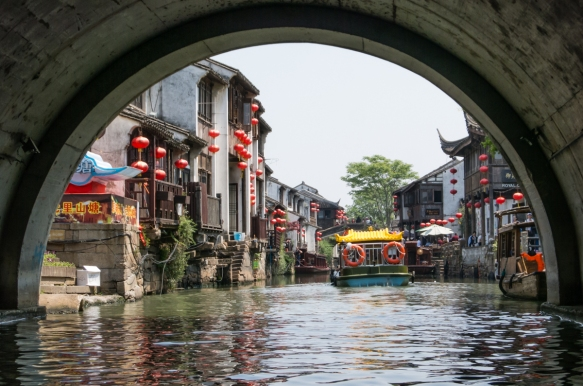 """Going through one of many bridge """"tunnels"""" on the Grand Canal, Suzhou, China"""