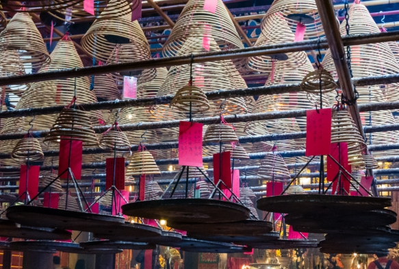 Hanging spiral incense burners with prayer notes In the Man Mo Temple, Hong Kong, S.A.R., People_s Republic of China
