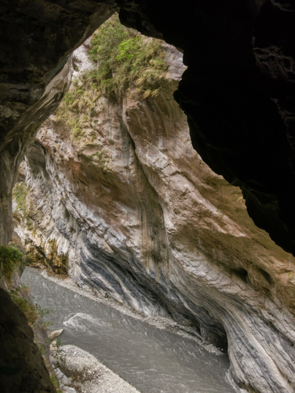 """Looking through a natural """"window"""" in the wall of the gorge wall at a portion of Swallow Grotto, Taroko National Park, Hualien, Taiwan"""