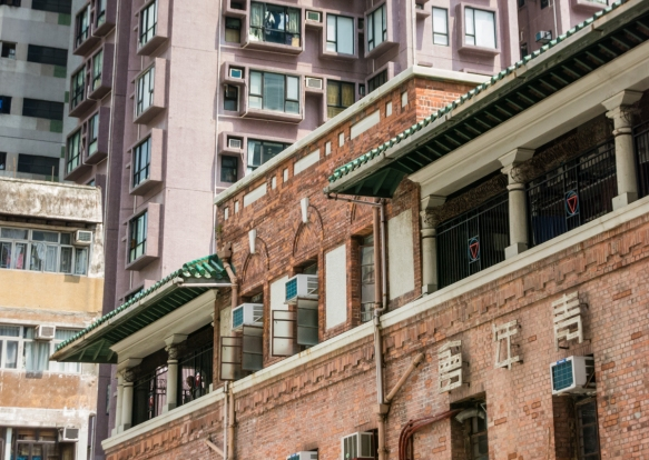 One of the cultural centers of the Sheung Wan neighborhood a century ago was the Bridges Street Center of the Chinese YMCA of Hong Kong, now surrounded by high rise apartment buildings;