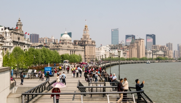 The Bund is a mile-long stretch of waterfront promenade along the Huangpu River in Shanghai, China, that is a living museum of the colonial history of the 1800s with 52 buildings of vari