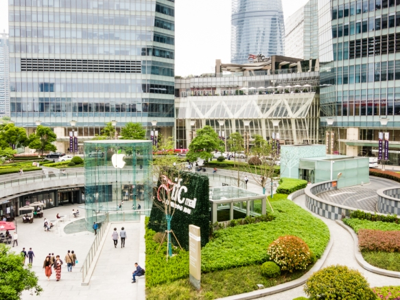 The entrance to the IFC [International Finance Center] Mall, Pudong district, Shanghai, China; note the elegant glass tower entrance to the below ground Apple store
