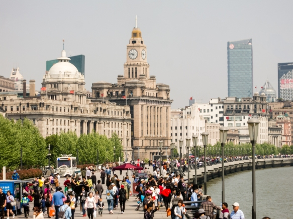 The government has done an excellent job preserving the historical buildings from the settlement period along the Bund, Shanghai, China; the newer skyscrapers stand in the distance in st
