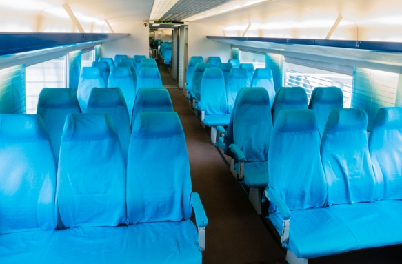 "The regular seating sections of the Shanghai Maglev Train, had smaller seats and were less luxurious (no leather upholstery) than the VIP (""first class"") seats"
