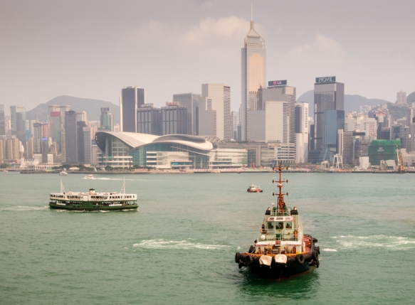 The tugboat helped guide us into our pier at the Ocean Terminal, Kowloon, Hong Kong, S.A.R., People_s Republic of China – across from the Convention and Expo Center and skyscrapers o