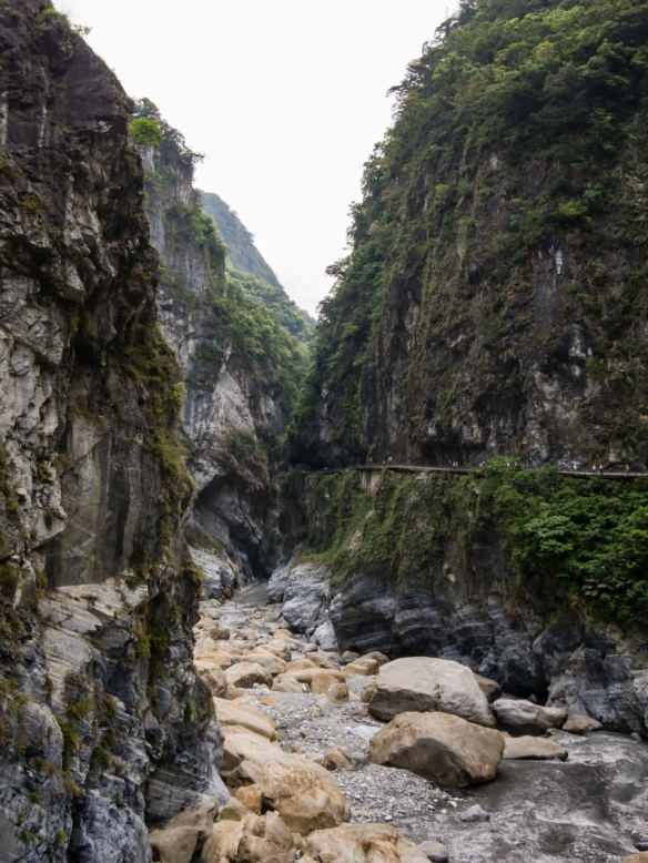 The walkway, carved through the gorge, is visible on the right side of this photograph of Swallow Grotto, Taroko National Park, Hualien, Taiwan