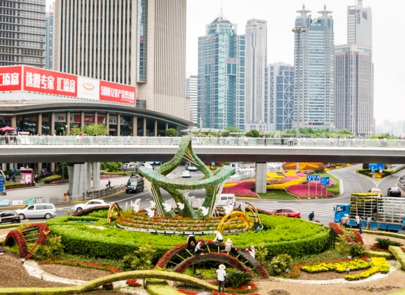 This traffic circle in the heart of the Lujiazui fiancial trade zone in Pudong has a circular, elevated pedestrian overpass for easy access to each of the four streets at the intersectio