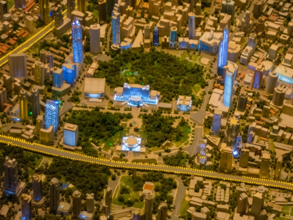This view of the scale model of the city focuses on People_s Square with the Shanghai Museum in the lower-center (just above the road outlined in yellow lights) and the Municipal Gover