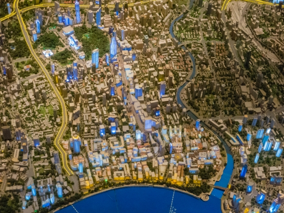 This view of the scale model of the city has the Bund on the lower edge of the image with the central business district in the center and the greenery on the upper left is People_s Par