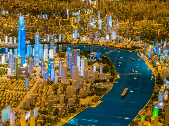 This view of the scale model of the city is from the opposite direction of the previous photographs, with the Bund in the center, on the upper side of the Huangpu River, and the new Pudo