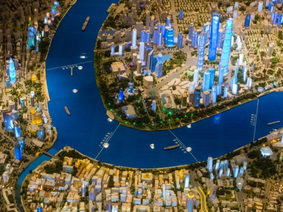 This view of the scale model of the city shows the Bund on the western bank of the Huangpu River on the bottom of the photograph, with the new skyscrapers of the Pudong district across t
