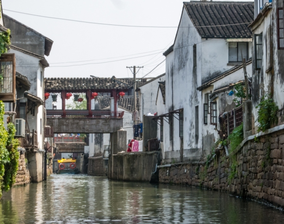 "Typical homes along the Grand Canal, Suzhou, China; many of the homes have belonged to the same family for many generations – sadly, the canal no longer has such a ""grand"" appearan"
