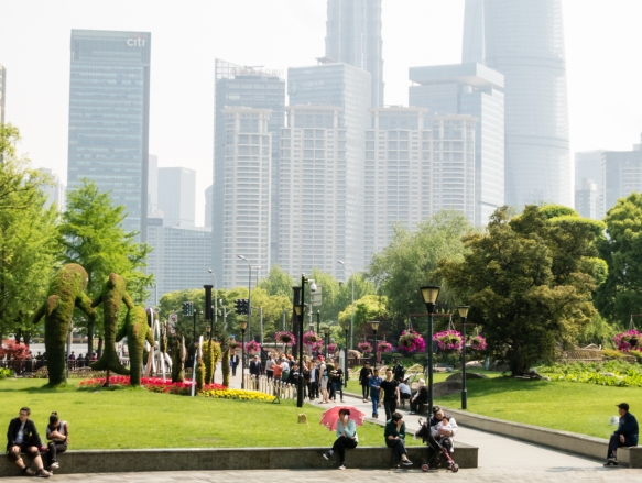 We left the Bund, Shanghai, China, for a short detour through an adjacent park, preserved for the green space, with numerous giant skyscrapers standing all around it