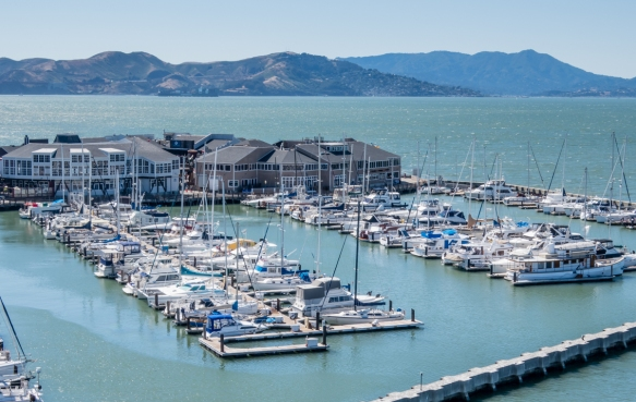 A close-up of the yacht basin between our pier (Pier 35) and the retail shops on Pier 39, San Francisco, CA, USA, with the Marin Headland hills visible in the background