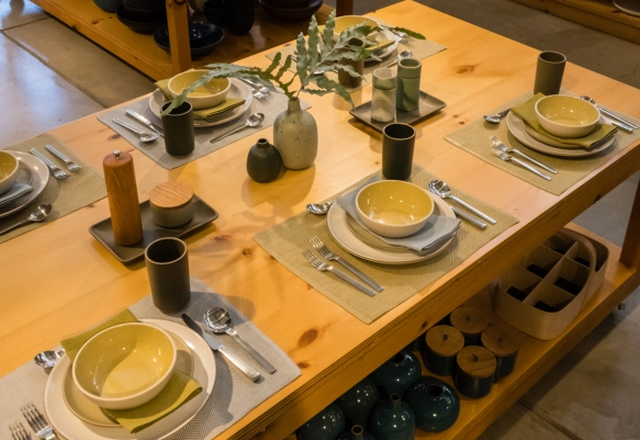 A display table setting showcasing a variety of tableware products, Heath Ceramics, San Francisco, CA, USA