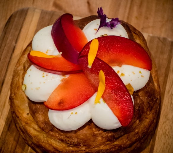 Almond brioche topped with mascarpone and fresh plum slices, Tartine Manufactory, San Francisco, CA, USA
