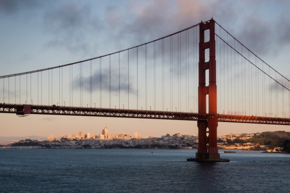 An iconic view of the city of San Francisco, CA, USA, behind the Golden Gate Bridge (whose construction began in 1930 and opened in 1937) with its International Orange paint