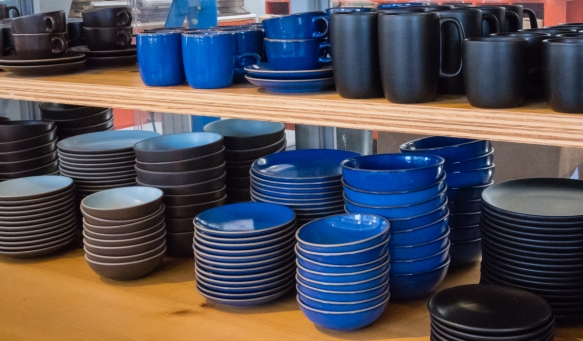 In addition to the muted earth tones which were popular early on, table ware is also made with bright colored glazes, Heath Ceramics, San Francisco, CA, USA