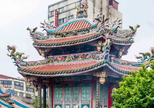 One of the annex buildings of Lungshan Temple; at the Temple worshipping includes a mixture of Buddhist and Taoist beliefs, and deities like Mazu; Taipei, Taiwan