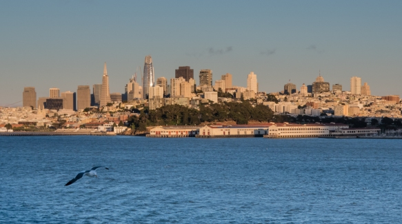 Sunset on San Francisco, CA, USA, with the former U.S. Army_s Fort Mason in the foreground (including the piers) and the Financial District in the background (left) with the Russian Hi