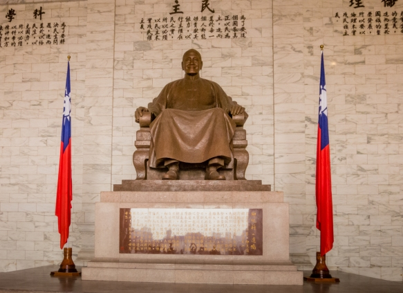"The characters behind Chiang Kai-Shek_s statue read ""Ethics"", ""Democracy"", and ""Science"", and the inscriptions on the side read ""The purpose of life is to improve the general life of h"
