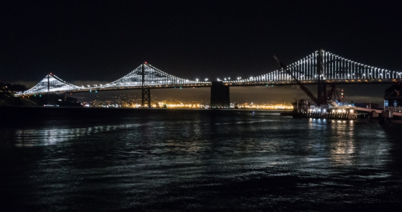 The dining room of The Slanted Door has this terrific view of the San Francisco – Oakland Bay Bridge which has special lights at night, San Francisco, CA, USA