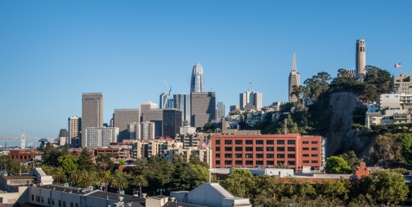 The final beam rising to the top of the tallest building in San Francisco, CA, was celebrated on 7 April 2017 with the topping-out ceremony of the Salesforce Tower (center) in the Financ