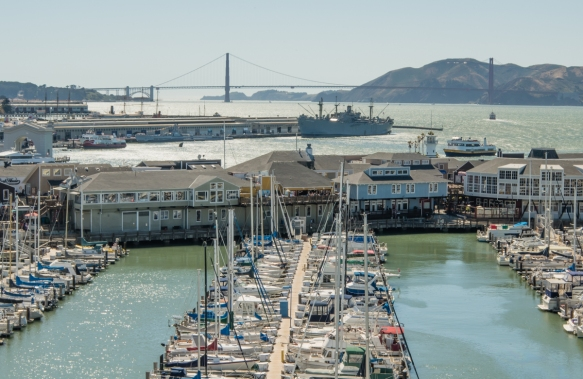 The view from our apartment on the ship while docked -- the yacht basin between our pier (Pier 35) and the retail shops on Pier 39 with the Golden Gate Bridge in the background, San Fran