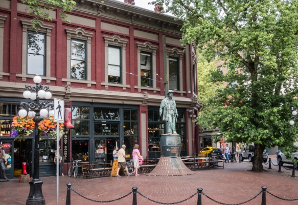 A major intersection in the city_s oldest neighborhood, Gastown, known for its late-Victorian architecture, cobblestone streets, and antique street lanterns, Vancouver, British Columbi