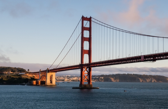 Approaching the Golden Gate Bridge, San Francisco, CA, USA, just before sunset from San Francisco Bay on the eastern side of the bridge; Fort Point is visible in the anchorage of the bri