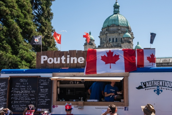 Belleville Street, in front of the British Columbia Parliament Building, during the Canada Day celebrations was lined with food trucks offering local specialties, including poutine, Vict