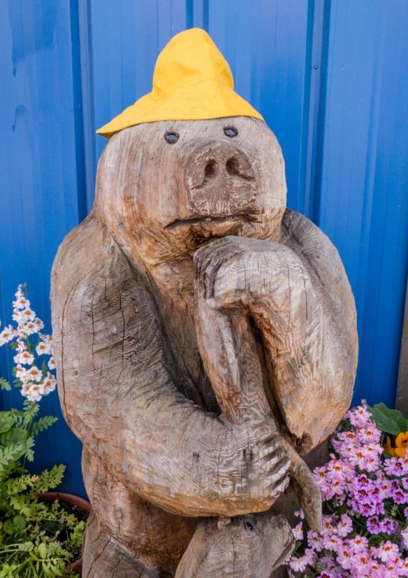 """Near the pier, this carved bear sported a """"Paddington Bear"""" yellow hat, Wrangell, Alaska, USA"""