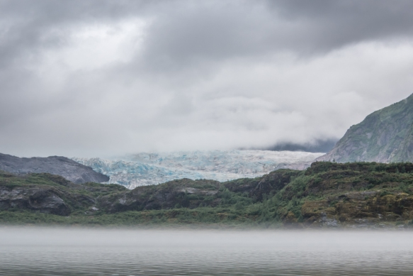 Our first glimpse of the tidewater entrance of the massive Mendenhall Glacier from behind a spit of land protruding into Lake Mendenhall, Juneau, Alaska, USA
