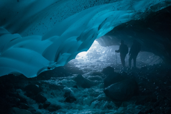 Our path through the Mendenhall ice cave (under Mendenhall Glacier) was upstream and uphill with the water flowing rapidly and, in some places, deeply – our trekking poles were as impo