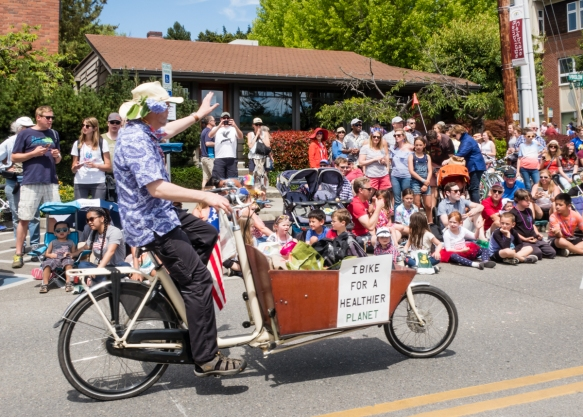 "Part of the climate action group, this biker_s sign read ""I bike for a healthier planet"", Grand Old 4th on Bainbridge Island, Washington, USA"