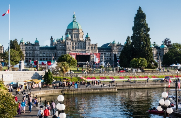 The British Columbia Parliament Buildings greet visitors to Victoria_s picturesque Inner Harbour, Victoria, British Columbia, Canada