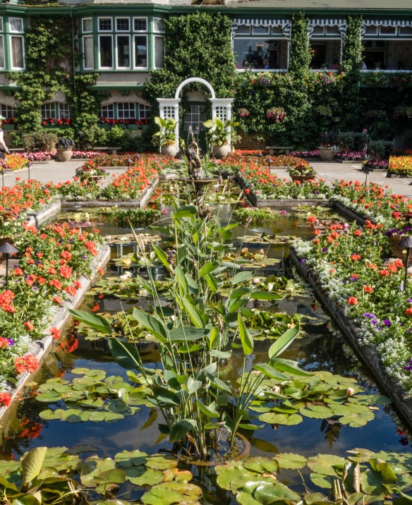 The cross-shaped pond in the Italian Garden is fed by a fountain depicting a child holding a fish, on the site of the former Butchart family_s tennis court; The Butchart Gardens, Victo