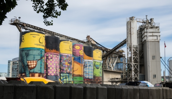 "The ""silos"" that are part of the cement factory on Granville Island, Vancouver, British Columbia, Canada, have been painted whimsically by a local artist"