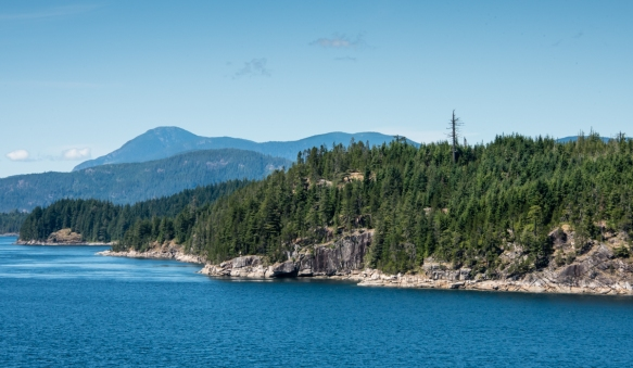 The Inside Passage weaves along thousands of Pacific Coast islands that are heavily forested, with the Coastal Mountains visible to the east, Fjordlands, British Columbia, Canada