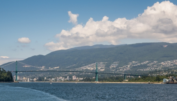 The Lions Gate Bridge with West Vancouver visible in the background, viewed from the Seawall walk on the middle of the east side of Stanley Park, Vancouver, British Columbia, Canada