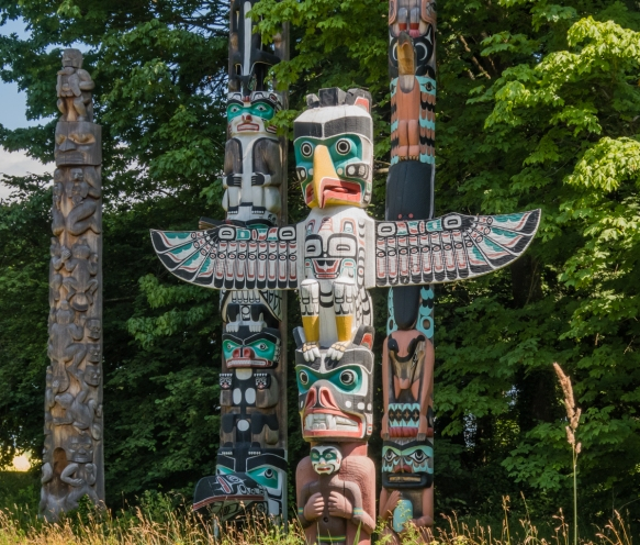 The nine totem poles at Brockton Point are BC's most visited tourist attraction, Stanley Park, Vancouver, British Columbia, Canada