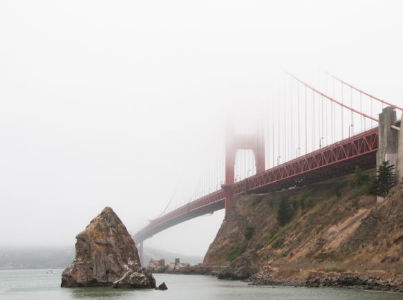 The north tower disappearing in the fog, viewed from Lime Point near Sausalito, CA; Golden Gate Bridge, San Francisco, CA, USA