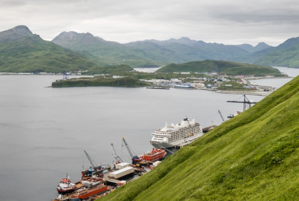 A view of our ship at the pier in Dutch Harbor, Unalaska, Alaska, and the main part of the town of Unalaska (across the bay from Dutch Harbor), taken as we hiked down from Fort Schwatka