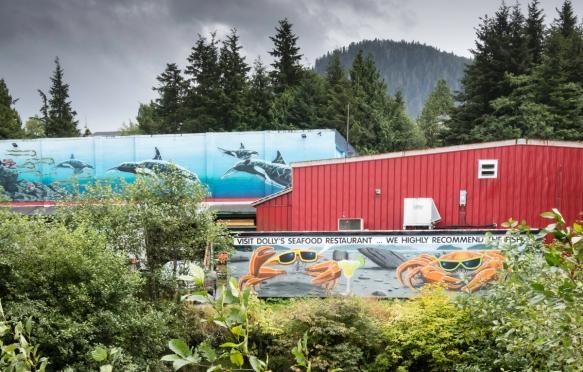 Also in Cow Bay is Dolly_s seafood restaurant and the company_s large fish processing plant in the back (with the mural of whales on the end of the building), Prince Rupert, British