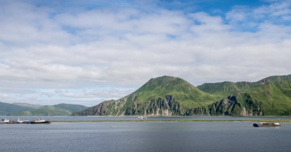 The Split Dock of Dutch Harbor, Amaknak Island, Alaska, USA, with the mountains of Unalaska Island in the background, across Iliuliuk Bay