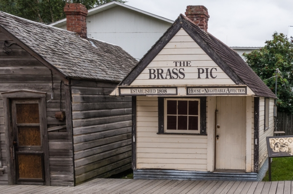 "The U.S. NPS (National Park Service) has moved and preserved a number of old historic buildings in Skagway, Alaska; the sign on ""The Brass Pic"" is self evident as to its former busin"