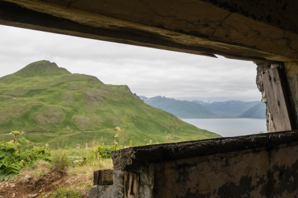 "The view of Mount Ballyhoo and the bay from the back ""slit"" in the upper level of the hillside Battery Command and Base End Station, Fort Schwatka, Dutch Harbor, Unalaska, Alaska"