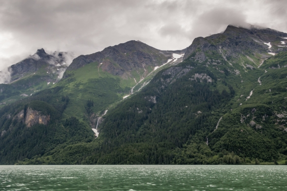 We could hear the roar of the snow-fed waterfall on the mountainside from a fair distance on Lake Chilkoot, as it was really calm and peaceful the sunny day we were out kayaking, Haines,
